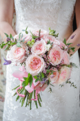 Pink roses in a wedding bouquet