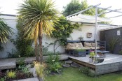 Contemporary garden with reclaimed materials